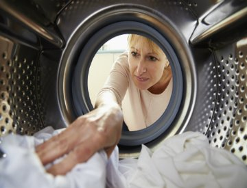 Use these tips to help your clothes dry faster, saving energy and money. ©iStockphoto.com/monkeybusinessimages