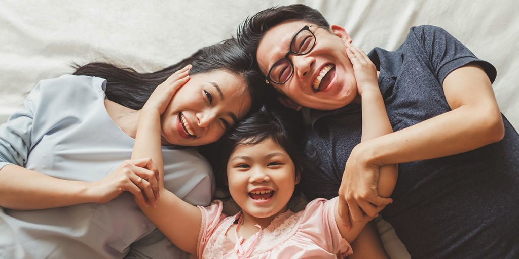 Happy family breathing easy with clean in-door air quality